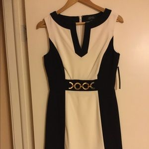 Tahari dress is n white and navy blue